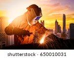 industrial worker welding steel ... | Shutterstock . vector #650010031