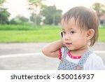 asian little girl talking on... | Shutterstock . vector #650016937