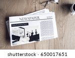 newspaper on wooden table | Shutterstock . vector #650017651