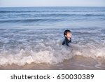 happy child playing sea on...   Shutterstock . vector #650030389