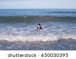 happy child playing sea on...   Shutterstock . vector #650030395