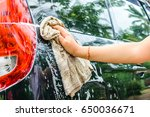 female hand washing a black car ... | Shutterstock . vector #650036671