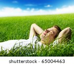 young man in spring grass | Shutterstock . vector #65004463