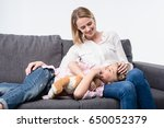 smiling mother with little... | Shutterstock . vector #650052379