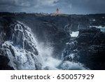 lighthouse above the black... | Shutterstock . vector #650057929