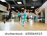 a group of girls jump with... | Shutterstock . vector #650064415