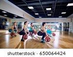 group training. girls do squats ... | Shutterstock . vector #650064424