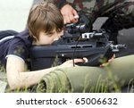teen boy aiming with the... | Shutterstock . vector #65006632