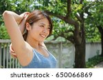 young woman warming up for... | Shutterstock . vector #650066869