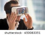 man in vr headset watching 3d... | Shutterstock . vector #650083351