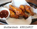 Small photo of Fried chicken. A Buffalo wing is an unbranded chicken wing section (flat or drumbeat) that is generally deep fried then coated in a sauce consisting of a vinegar based cayenne pepper hot sauce.