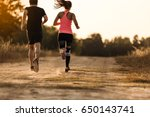 young couple running at forest... | Shutterstock . vector #650143741