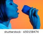 African american girl drinking...