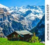 wooden house with switzerland...   Shutterstock . vector #650164009
