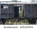 old wooden ruined boxcar | Shutterstock . vector #650165941