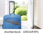 blue vacation suitcase by... | Shutterstock . vector #650169391