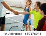 proud tennis coach praising kid ... | Shutterstock . vector #650176045
