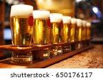 ten beer glasses in a row in a...   Shutterstock . vector #650176117