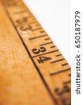 close shot of an old yardstick... | Shutterstock . vector #650187979