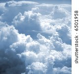 Small photo of kind on clouds on a background a firmament from an airplane