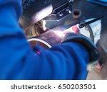 welder is welding on test... | Shutterstock . vector #650203501