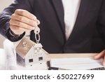 real estate agent handing over... | Shutterstock . vector #650227699