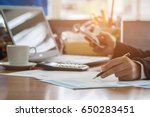 a business woman analyzing... | Shutterstock . vector #650283451