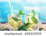 lemonade with fresh lemon with... | Shutterstock . vector #650325559