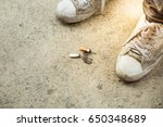 cigarettes with shoes on the... | Shutterstock . vector #650348689