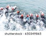 triathlon competitors in swim  ... | Shutterstock . vector #650349865