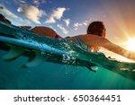 half water shot of a surfer... | Shutterstock . vector #650364451