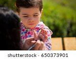 mom writes in the palm of his... | Shutterstock . vector #650373901