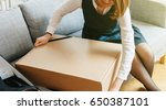 unboxing cardboard by young... | Shutterstock . vector #650387101