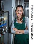 portrait of female factory... | Shutterstock . vector #650400811