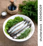Small photo of Slightly salted capelin with dill. Rustic style.