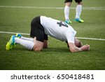 disappointed football player | Shutterstock . vector #650418481