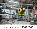 attentive factory worker... | Shutterstock . vector #650422945