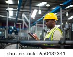factory worker writing on the... | Shutterstock . vector #650432341