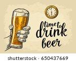 male hand holding glass beer... | Shutterstock .eps vector #650437669