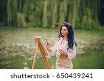 artist girl walks in the park.... | Shutterstock . vector #650439241