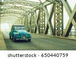 old blue vintage car driving on ... | Shutterstock . vector #650440759