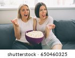 women eating popcorn and... | Shutterstock . vector #650460325