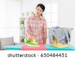 sweet attractive mother doing... | Shutterstock . vector #650484451