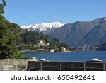 Full view of Cernobbio and Lake Como beyond, with snow capped mountains in the background