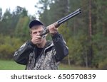 Small photo of Chelyabinsk Region, Russia - September 17, 2016: A hunter in a camouflage shoots a gun. Hunter in the forest of autumn taking aim in the bird.