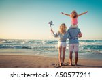 happy family on the beach.... | Shutterstock . vector #650577211