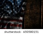 usa flag on a wood surface | Shutterstock . vector #650580151