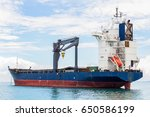 cargo ship waiting to receive... | Shutterstock . vector #650586199