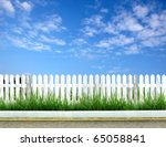White Fence With Road And Blue...
