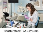 young female assistant working... | Shutterstock . vector #650598301